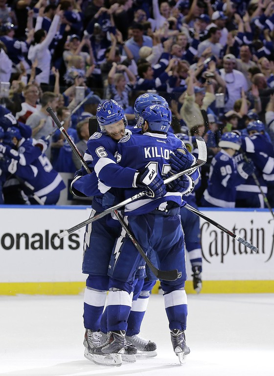 . Tampa Bay Lightning defenseman Anton Stralman (6), of Sweden, celebrates with center Alex Killorn (17) after scoring against the Detroit Red Wings during the third period of Game 7 of a first-round NHL Stanley Cup hockey playoff series Wednesday, April 29, 2015, in Tampa, Fla. The Lightning won the game 2-0. (AP Photo/Chris O\'Meara)