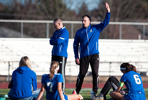 11/07/18 Wesley Bunnell | Staff Southington girl soccer was defeated in PK by Simsbury in a second round Class LL CIAC Tournament game on Wednesday night. Head coach Mike Linehan speaks to the team during the half.