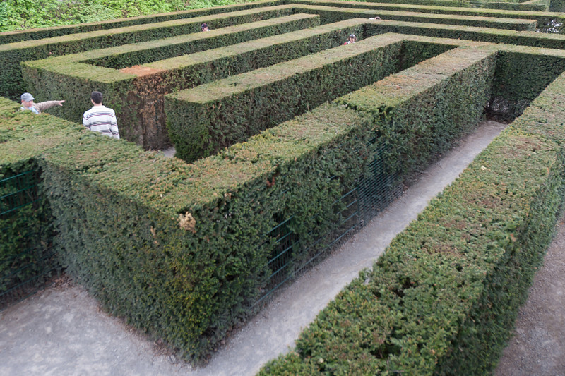 Tourists navigating the hedge maze in Schonbrunn Garden - Vienna, Austria