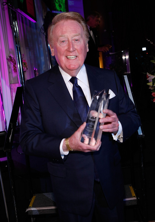 . LOS ANGELES, CA - MARCH 09:  Los Angeles Dodger announcer Vin Scully receives the AMEE Award in Broadcasting during the 2009 AFTRA Media and Entertainment Excellence Awards at the Biltmore Hotel on March 9, 2009 in Los Angeles, California.  (Photo by Michael Buckner/Getty Images)