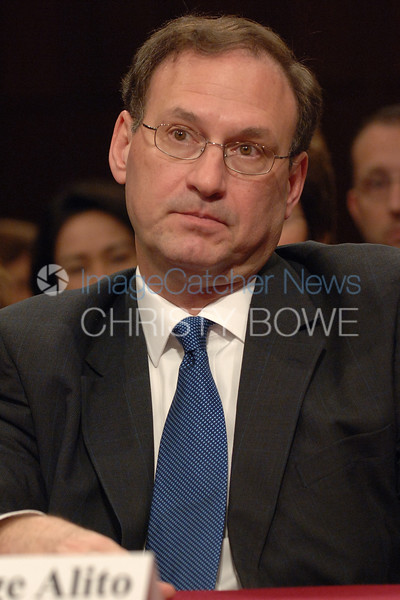 Supreme Court Justice nominee Samuel Alito listens to  questions by the Senate Judiciary Committee.
