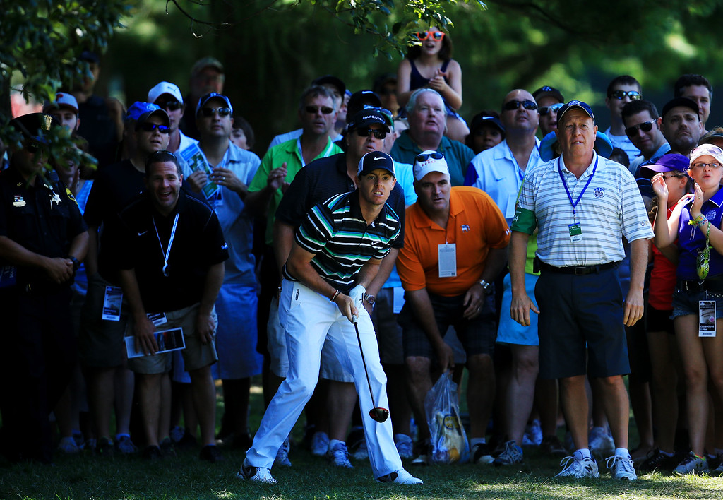 . ROCHESTER, NY - AUGUST 10:  Rory McIlroy of Northern Ireland watches a shot from the rough on the fourth hole during the third round of the 95th PGA Championship on August 10, 2013 in Rochester, New York.  (Photo by David Cannon/Getty Images)