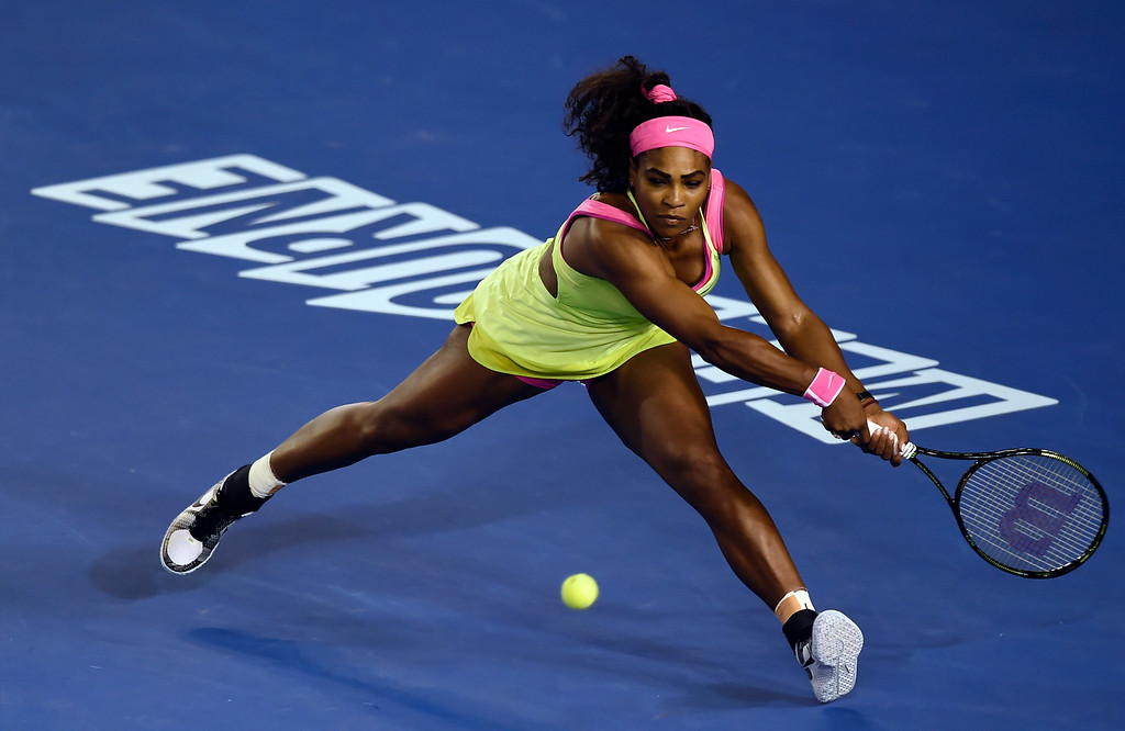 . Serena Williams of the U.S. reaches for a shot to Maria Sharapova of Russia during the women\'s singles final at the Australian Open tennis championship in Melbourne, Australia, Saturday, Jan. 31, 2015. (AP Photo/Andy Brownbill)