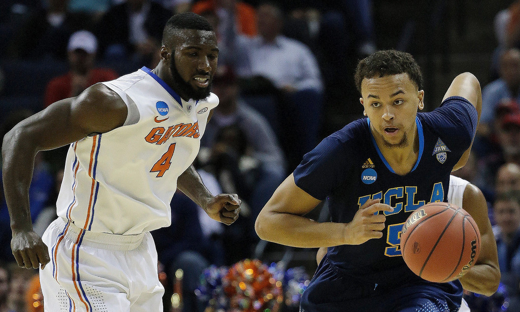 . UCLA\'s Kyle Anderson (5) steals the ball from Florida\'s Patric Young (4) during the second half in a regional semifinal game at the NCAA college basketball tournament, Thursday, March 27, 2014, in Memphis, Tenn. (AP Photo/Mark Humphrey)