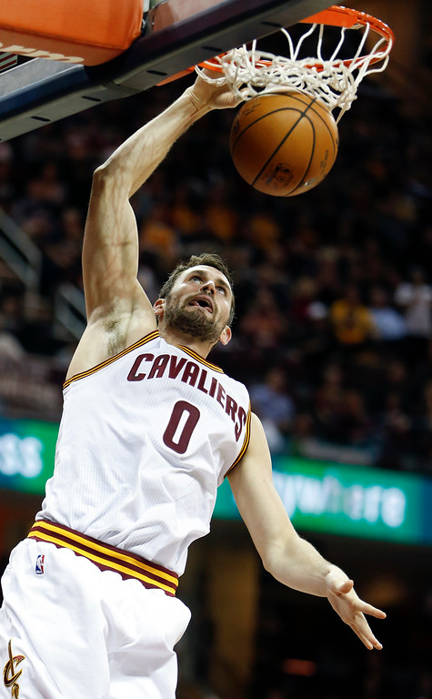 . Cleveland Cavaliers\' Kevin Love dunks against the Charlotte Hornets during the first half of an NBA basketball game, Sunday, Nov. 13, 2016, in Cleveland. (AP Photo/Ron Schwane)