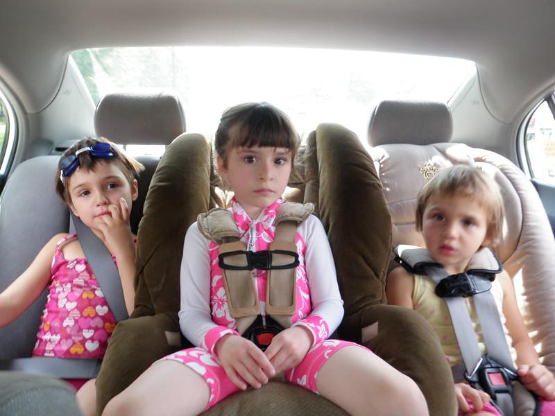 Three girls in the car.