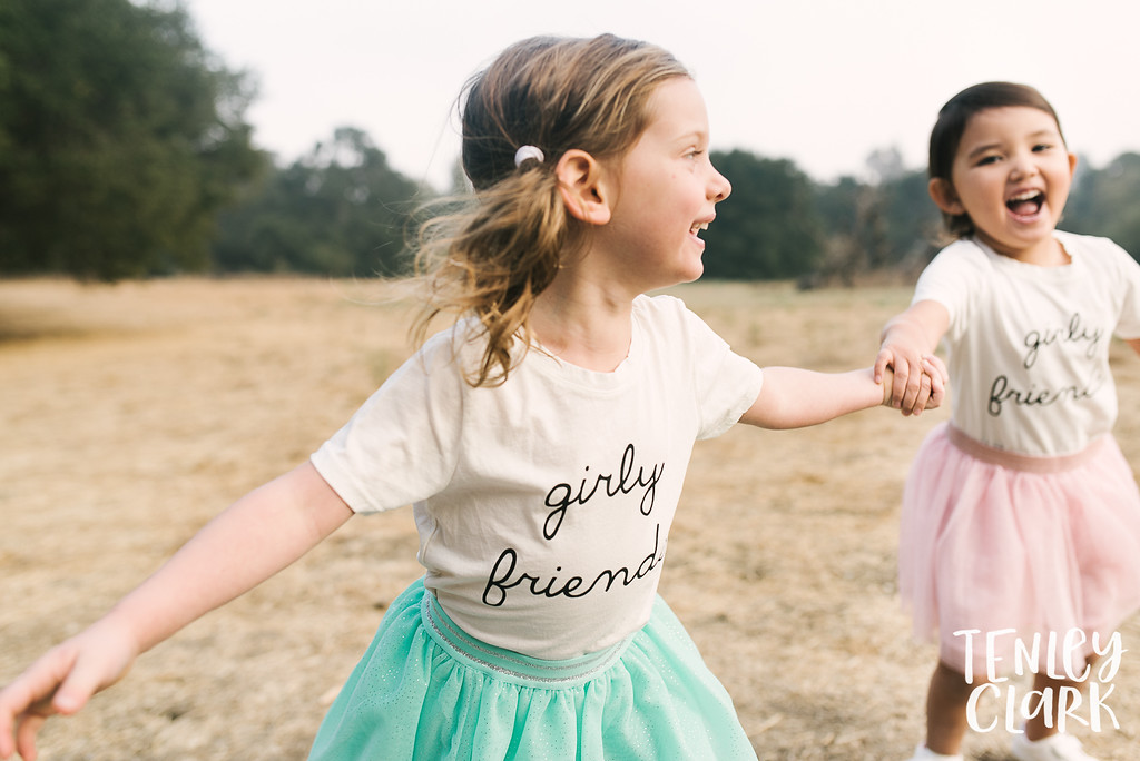 Little girl friends. Playful kids fashion commercial brand shoot  for B+C California a kids t-shirt company in Bay Area by Tenley Clark Photography.