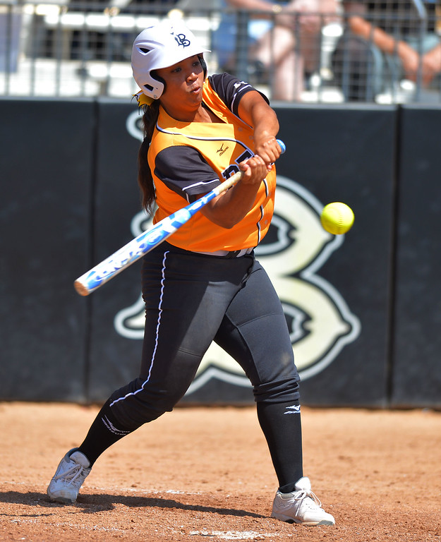 . LBSU\'s Ashlynn Booker connects for a 6th inning double as LBSU lost to Cal Poly softball 3-0 in Long Beach, CA on Sunday, May 4, 2014.  (Photo by Scott Varley, Daily Breeze)