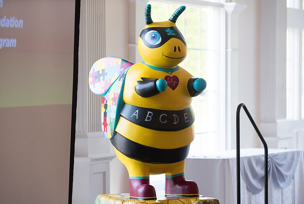 06/12/19 Wesley Bunnell | Staff A bee decorated as part of the Bees Across New Britain project features autism awareness puzzle pieces on its wings is on display on June 12, 2019 during the Center of Special Care meeting at the Aqua Turf in Southington.