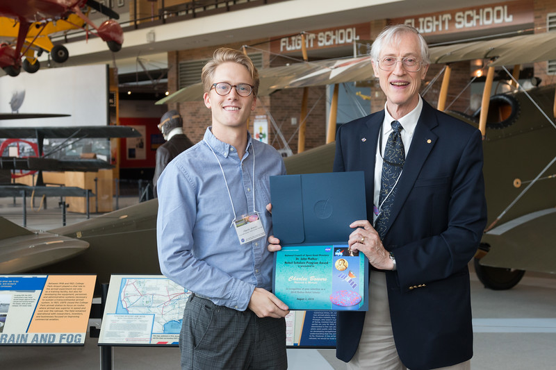 """Charles Bowers with John Mather, in front of Curtiss Jenny JN-4 -- An award luncheon, """"Dr. John Mather Nobel Scholars Program Award"""", as part of the National Space Grant Foundation. College Park Aviation Museum, College Park, MD, August 2, 2019."""
