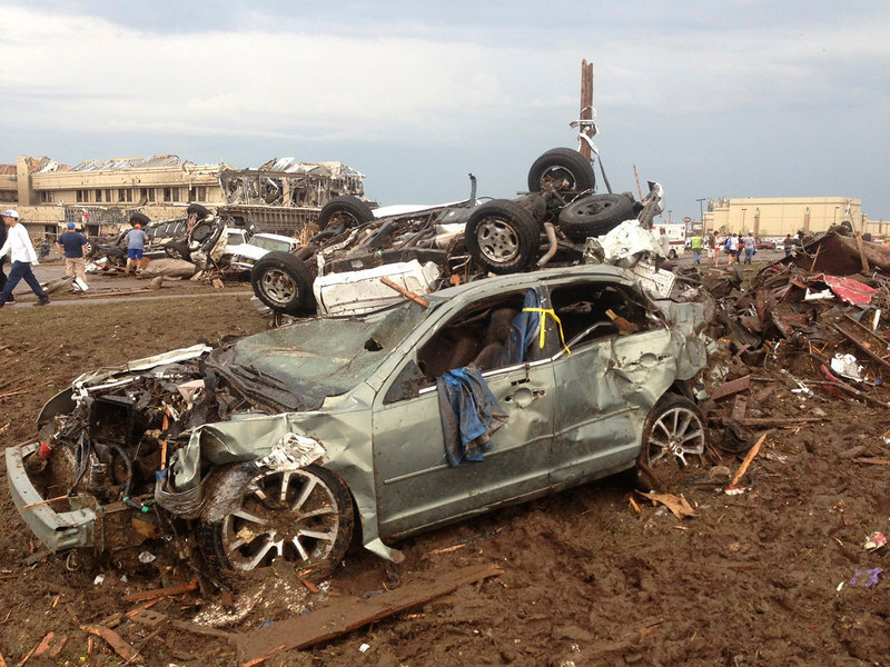 . Overturned cars are seen from destruction from a huge tornado near Oklahoma City, Oklahoma  May 20, 2013.  A huge tornado touched down on Monday near Oklahoma City, and the National Weather Service urged residents to immediately take cover as a massive storm system in the middle of the country threatened to pummel as many as 10 states.  REUTERS/Richard Rowe