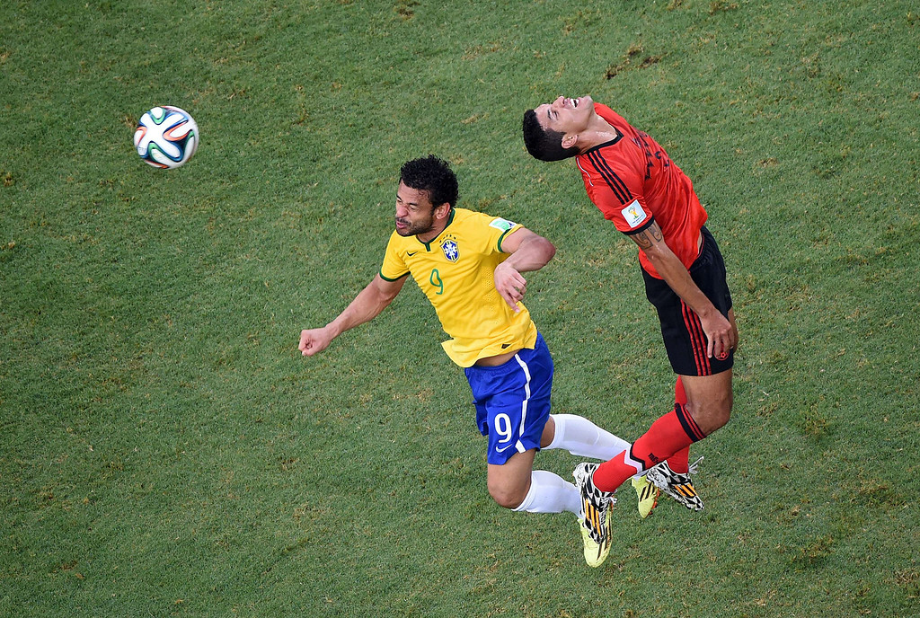 . Brazil\'s forward Fred (L) vies with Mexico\'s defender Francisco Rodriguez (R) a Group A football match between Brazil and Mexico in the Castelao Stadium in Fortaleza during the 2014 FIFA World Cup on June 17, 2014. FRANCOIS XAVIER MARIT/AFP/Getty Images