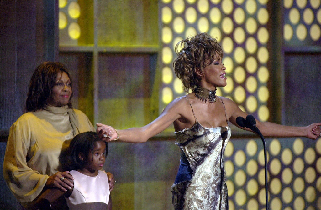. Whitney Houston, right, thanks the crowd after being honored with a lifetime achievement award at the first BET awards Tuesday, June 19, 2001, at a hotel in Las Vegas.  (AP Photo/Joe Cavaretta)