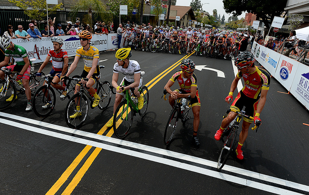 . Riders in the Sunset Road Race for Men line up at the starting line in Redlands Sunday April 7, 2013 during the Redlands Bicycle Classic. Crowds of spectators gather along the streets of Redlands for the final day of the 29th Annual Redlands Bicycle Classic. Rick Sforza/Staff photographer