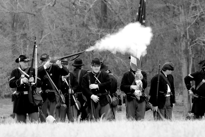 A Union infantry reenactor fires his rifle toward the Confederate line. The Skirmish at Gamble's Hotel happened on March 5, 1885 when 500 federal soldiers, under the command of Reuben Williams of the 12th Indiana Infantry, marched into Florence to destroy the railroad depot but were met by Confederate soldiers backed up with 400 militia. The reenactment, held by the 23rd South Carolina Infantry, was held at the Rankin Plantation in Florence, South Carolina on Saturday, March 5, 2011. Photo Copyright 2011 Jason Barnette