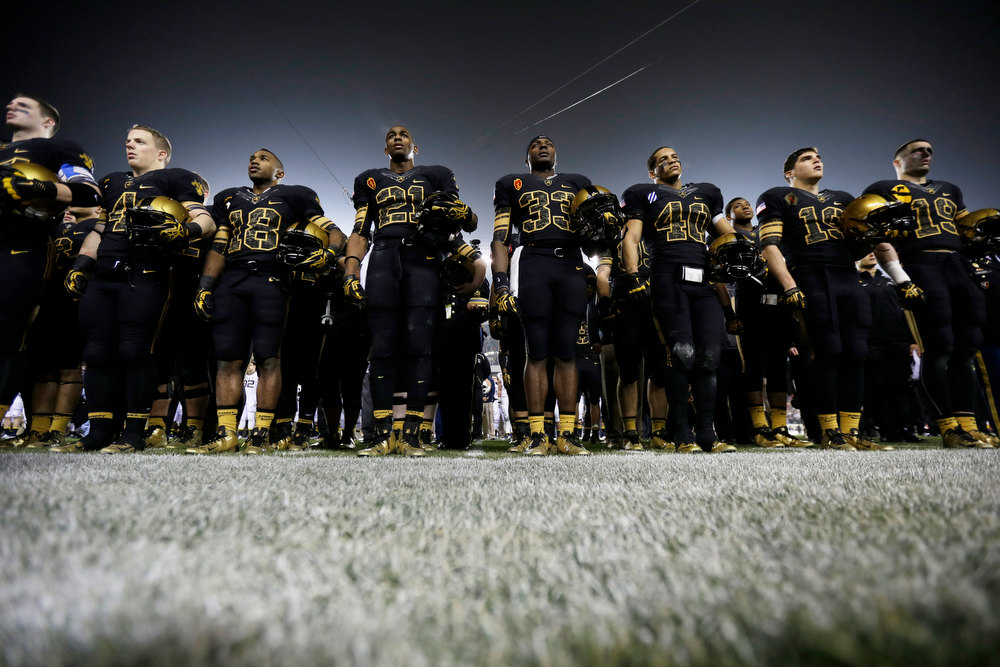 . Members of the Army team stand for the singing of school song after an NCAA college football game against Navy Saturday, Dec. 8, 2012, in Philadelphia. Navy won 17-13. (AP Photo/Matt Rourke)