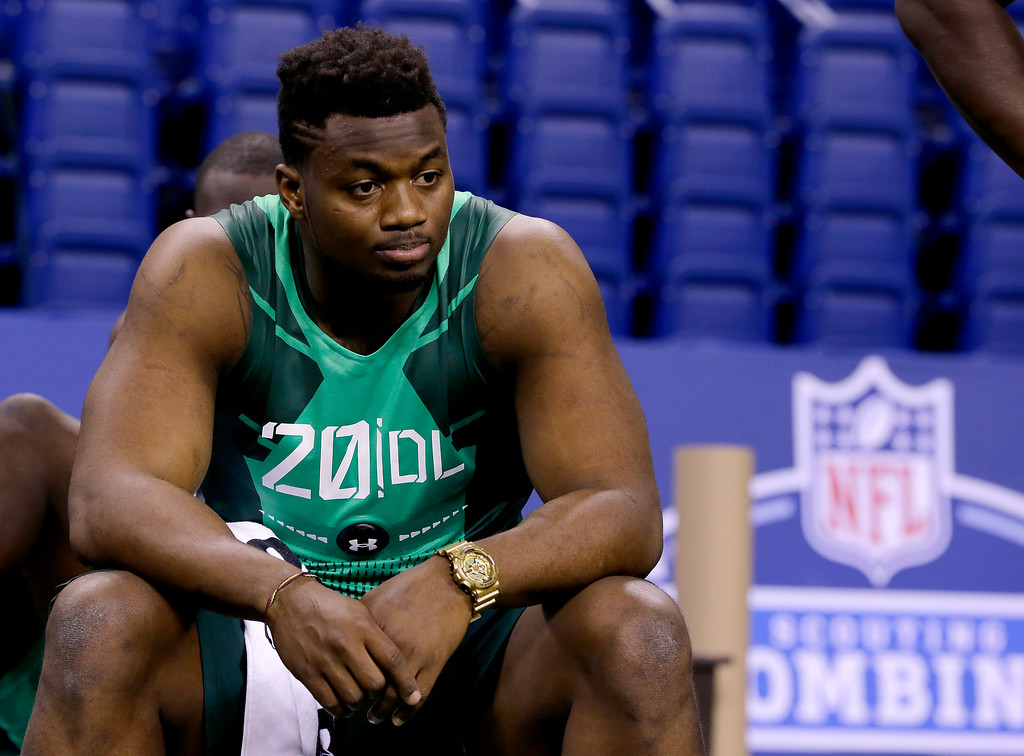 . Florida defensive lineman Dante Fowler looks on as prospects are measured at the NFL football scouting combine in Indianapolis, Sunday, Feb. 22, 2015. (AP Photo/Julio Cortez)