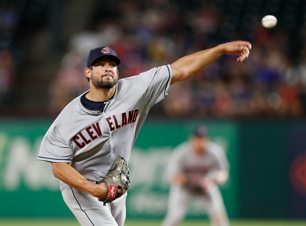 . Cleveland Indians pitcher Brad Hand delivers to a Texas Rangers batter during the seventh inning of a baseball game, Friday, July 20, 2018, in Arlington, Texas. (AP Photo/Jim Cowsert)