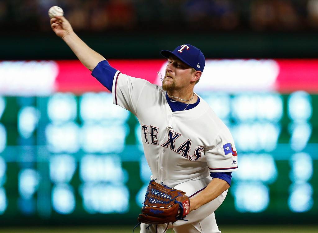 . Texas Rangers relief pitcher Austin Bibens-Dirkx delivers a pitch to a Cleveland Indians batter during the ninth inning of a baseball game, Saturday, July 21, 2018, in Arlington, Texas. The Indians won 16-3. (AP Photo/Jim Cowsert)