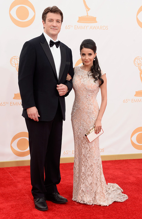. Actor Nathan Fillion (L) and actress Mikaela Hoover arrive at the 65th Annual Primetime Emmy Awards held at Nokia Theatre L.A. Live on September 22, 2013 in Los Angeles, California.  (Photo by Frazer Harrison/Getty Images)