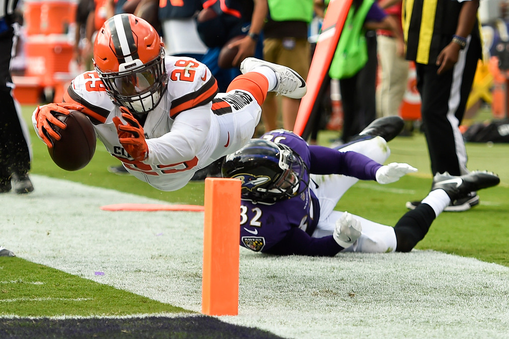 . Cleveland Browns running back Duke Johnson (29) is stopped just short of a touchdown by Baltimore Ravens free safety Eric Weddle (32) during the second half of an NFL football game in Baltimore, Sunday, Sept. 17, 2017. (AP Photo/Gail Burton)