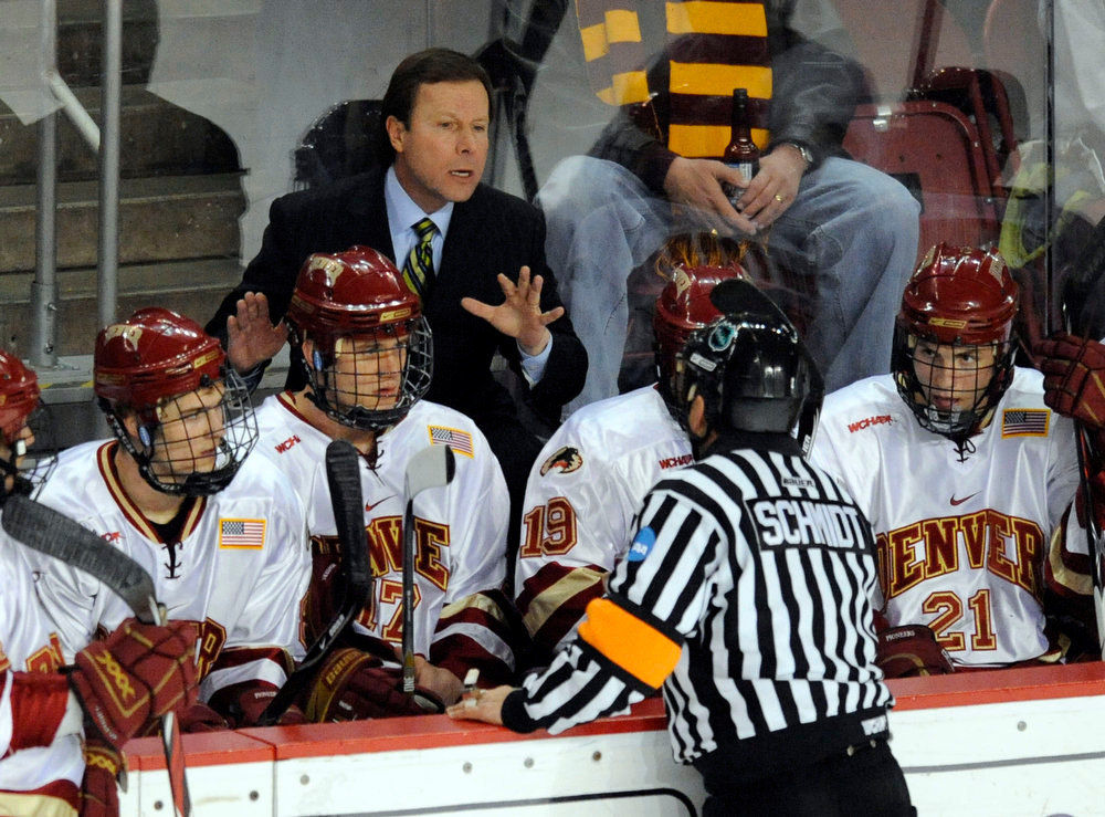 . University of Denver Pioneers head coach, George Gwozdecky argues with a referee on a goal scored by Podge Turnbull, #8, Wisconsin Badgers in the first  period of play at Magness Arena Saturday evening. THE DENVER POST/ ANDY CROSS