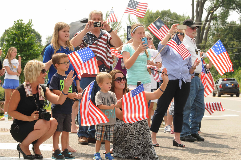 . Spectators pay their respects as hundreds of police cars pass by on Dodd Road, on their way to the burial service for Mendota Heights police officer Scott Patrick at Acacia Park Cemetery.   (Pioneer Press: Scott Takushi)