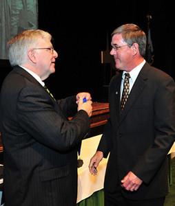President Kopp (left) presents medal to Steven Barnett, professor of Music, Marshall & Shirley Reynolds Outstanding Teacher Award