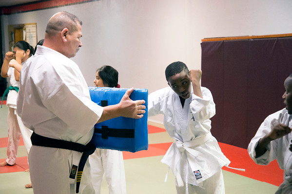 01/07/20 Wesley Bunnell | StaffrrInstructor Jose Ithier walks through a class with a punching target at New Britain Judo & Dynamic Arts on West Main St in New Britain.
