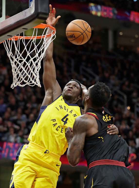 . Indiana Pacers\' Victor Oladipo, left, drives to the basket against Cleveland Cavaliers\' Jeff Green in the second half of Game 7 of an NBA basketball first-round playoff series, Sunday, April 29, 2018, in Cleveland. The Cavaliers won 105-101. (AP Photo/Tony Dejak)