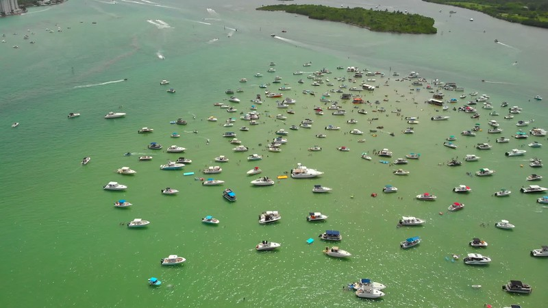 Aerial pull out reveal Haulover sand bar