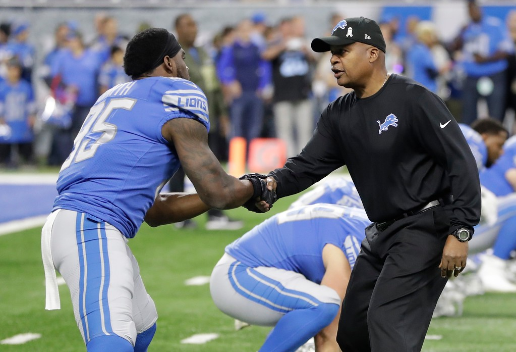 . Detroit Lions head coach Jim Caldwell greets defensive end Jacquies Smith (95) during pregame of an NFL football game against the Cleveland Browns, Sunday, Nov. 12, 2017, in Detroit. (AP Photo/Carlos Osorio)