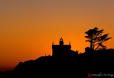 The sun sets behind Battery Point lighthouse