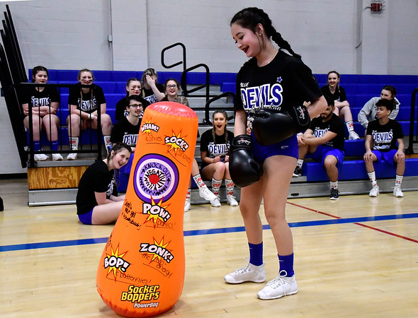 3/6/2020 Mike Orazzi | Staff Plainville High School Cheerleaders punches out their negative thoughts while preparing for the state competition on Friday night at PHS.
