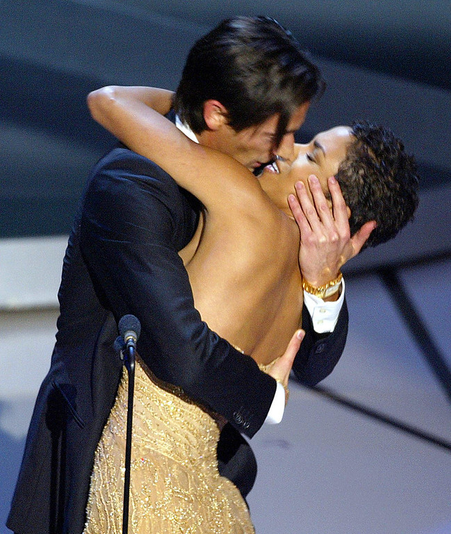 ". Actor Adrien Brody kisses presenter Actress Halle Berry as he accepts his Oscar for Performance by an actor in a leading role for his role in ""The Pianist\"" during the 75th Academy Awards at the Kodak Theatre in Hollywood, California, 23 March, 2003.  TIMOTHY A. CLARY/AFP/Getty Images"
