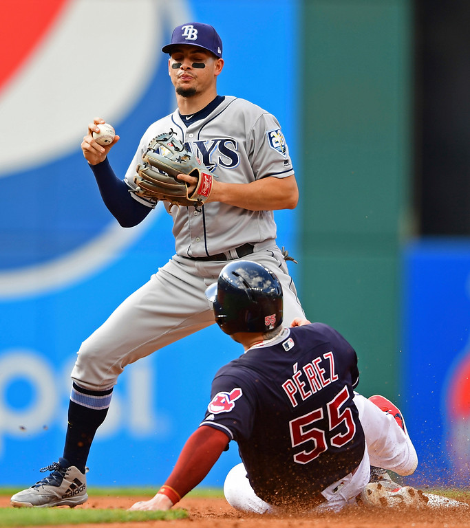 . Tampa Bay Rays\' Willy Adames, top, forces out Cleveland Indians\' Roberto Perez at second base in the third inning of a baseball game against the XXX, Sunday, Sept. 2, 2018, in Cleveland. Greg Allen would be safe at first on a the fielders choice. (AP Photo/David Dermer)