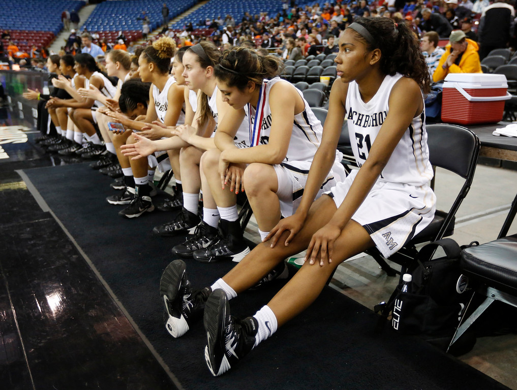 . Archbishop Mitty guard Kelli Hayes, right, watches as Chaminade players celebrate their 80-51 win in the girls\' Division 2 CIF basketball championship game Saturday, March 29, 2014, in Sacramento, Calif.(AP Photo/Rich Pedroncelli)