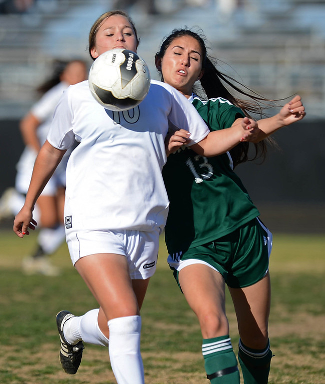 . Peninsula\'s Victoria Buda (10) brings the ball under control against Canyon\'s Kristina Watanabe (13) in a CIF SS Division II first round soccer game Thursday in Rolling Hills Estates. After Peninsula seemingly dominated most of the game, Canyon scored a goal in the final two minutes to win 1-0. 20130214 Photo by Steve McCrank / Staff Photographer