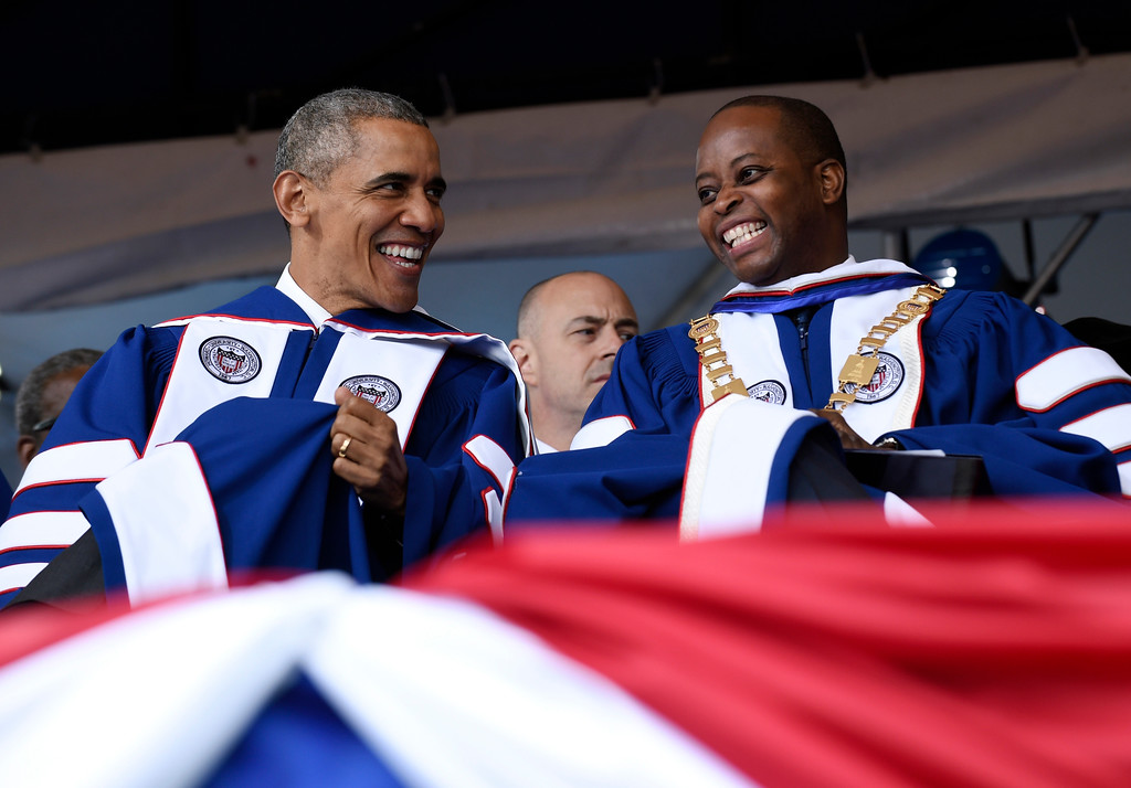 . President Barack Obama, left, talks with Howard University President Wayne A.I. Frederick, right, during the commencement ceremony for the 2016 graduating class of Howard University in Washington, Saturday, May 7, 2016. (AP Photo/Susan Walsh)