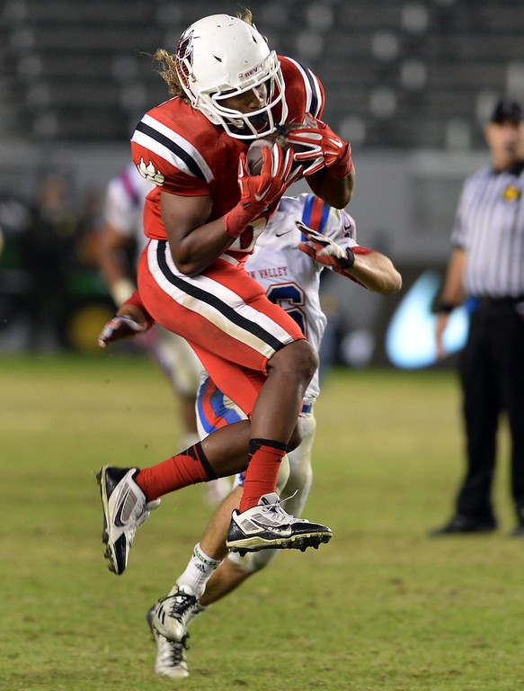 . Redlands East Valley High School\'s Malik Lovette completes a catch during the CIF-State Division II championship against Clayton Valley Charter on Saturday, December 20, 2014 at StubHub Center in Carson, Ca. REV won the game 34-33. (Photo by Micah Escamilla/Redlands Daily Facts)