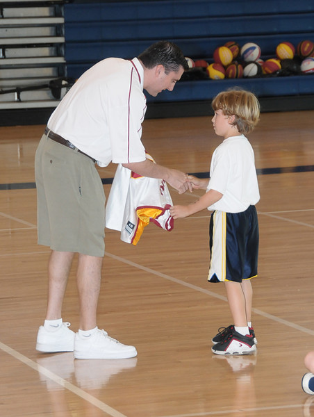 Max wins the grand prize at the Summer basketball camp shootout