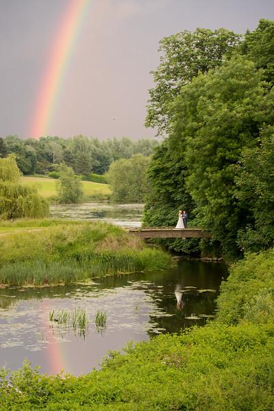 wedding couple under a rainbow
