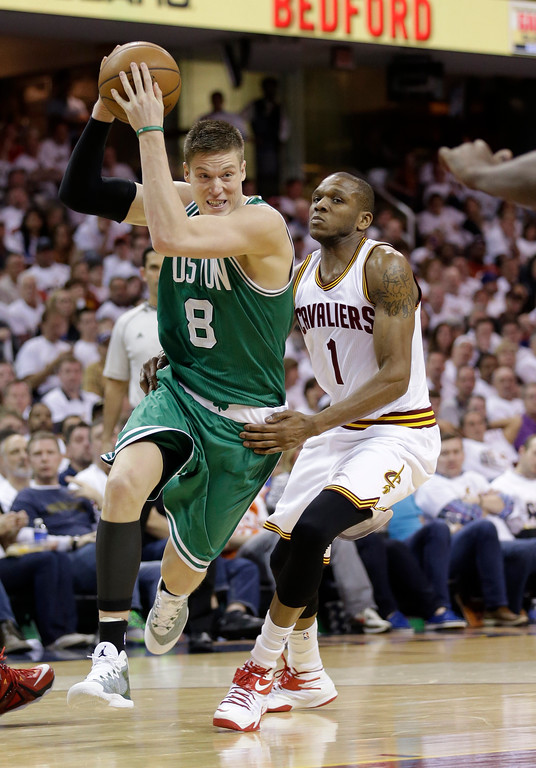 . Boston Celtics� Jonas Jerebko (8), from Sweden, drives past Cleveland Cavaliers\' James Jones (1) during the first round NBA playoff basketball game Sunday, April 19, 2015, in Cleveland. (AP Photo/Tony Dejak)