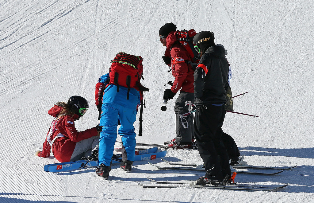 . Kaya Turski of Canada is treated by medical personnel during training for Ski Slopestyle at the  Extreme Park at Rosa Khutor Mountain on February 5, 2014 in Sochi, Russia.  (Photo by Mike Ehrmann/Getty Images)