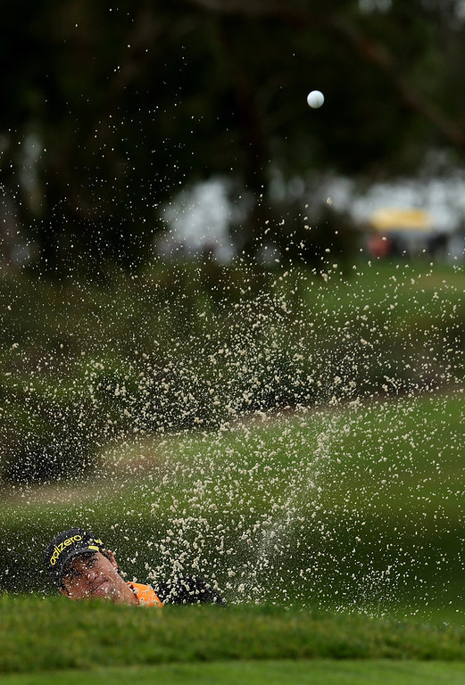 . Casey Wittenberg hits out of a bunker on the sixth hole during the third round of the Farmers Insurance Open on the South Course at Torrey Pines Golf Course on January 27, 2013 in La Jolla, California.  (Photo by Stephen Dunn/Getty Images)