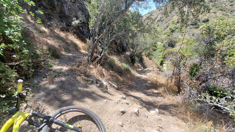 USAC, Bifurcation. Left is a billy-goat trail go-around for the right's steep descent and rock drop