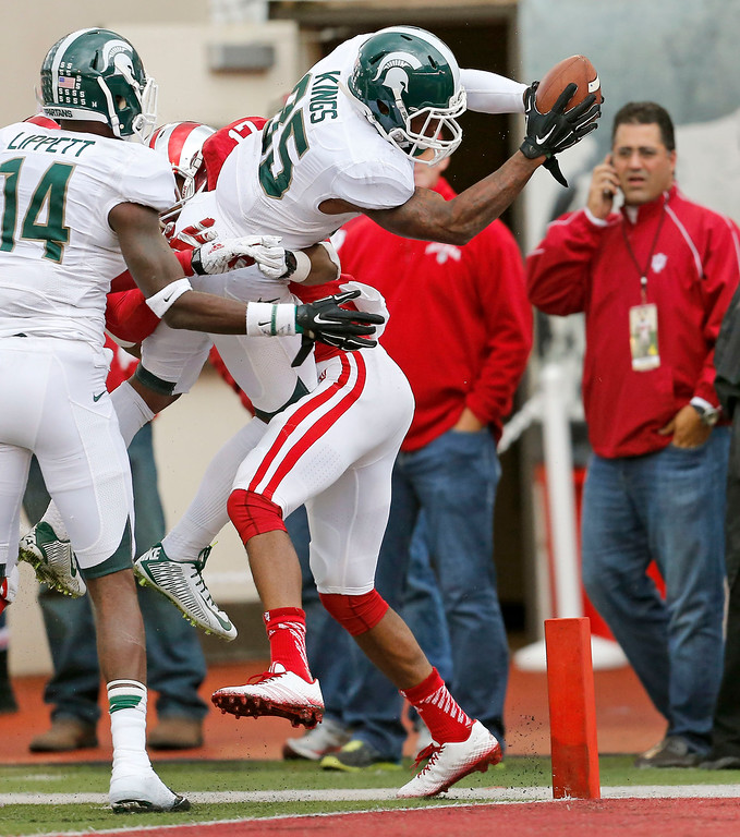 . Michigan State wide receiver Macgarrett Kings Jr. (85) scores against Indiana in the second half of an NCAA college football game in Bloomington, Ind., Saturday, Oct. 18, 2014. (AP Photo/Sam Riche)