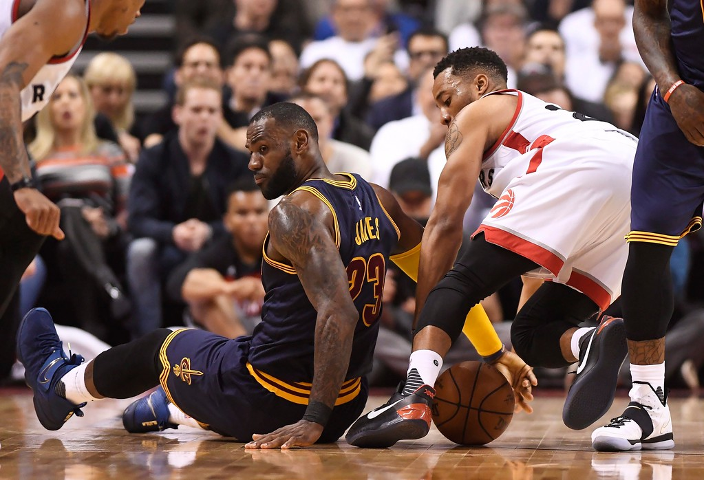 . Cleveland Cavaliers forward LeBron James (23) and Toronto Raptors guard Norman Powell (24) battle for the ball during the first half of Game 3 of an NBA basketball second-round playoff series in Toronto on Friday, May 5, 2017. (Frank Gunn/The Canadian Press via AP)