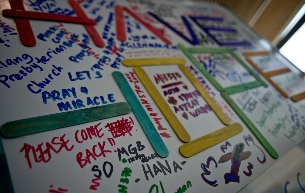. A board displaying messages for the missing passengers of Malaysia Airlines flight MH370 is seen at Kuala Lumpur International Airport in Sepang on March 11, 2014.  Malaysia has expanded its search area for the missing jet after three days of scouring the sea failed to bring forth any confirmed sightings of wreckage, an official said. (MANAN VATSYAYANA/AFP/Getty Images)