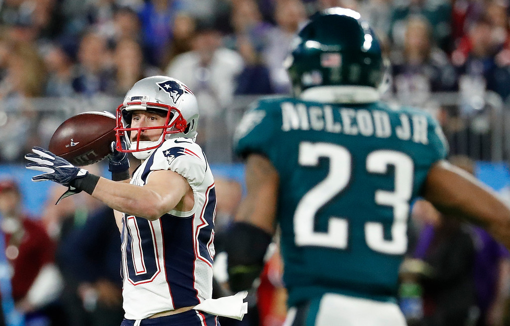 . New England Patriots\' Danny Amendola, left, throws a pass to quarterback Tom Brady during the first half of the NFL Super Bowl 52 football game against the Philadelphia Eagles Sunday, Feb. 4, 2018, in Minneapolis. (AP Photo/Matt York)